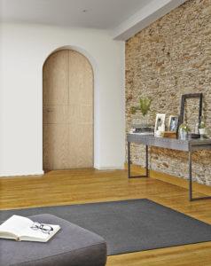 Porte d'entrée mixte bois aluminium cintrée